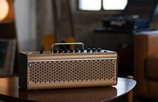 Yamaha THR30IIA Wireless sitting on side table in living room setting