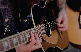close-up view of Fender Tim Armstrong Anniversary Hellcat being played by Tim Armstrong