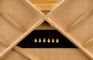 detail view of Fender acoustic guitar interior showing scalloped bracing design and construction