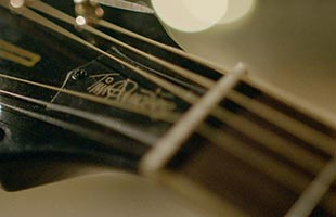 detail view of Tim Armstrong Anniversary Hellcat showing Tim Armstrong signature truss rod cover