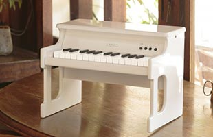 Korg TinyPiano on table with window to outdoors in background