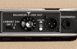 detail image of Fender Tone Master Deluxe Reverb Blonde amplifier rear panel showing balanced XLR line output and footswitch input
