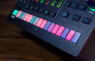 detail image of Roland TR-6S panel focusing on step buttons lit up in various colors
