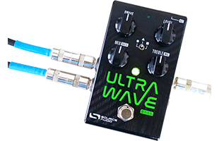 top view of Source Audio Ultrawave Bass Multiband Processor with audio cables connected to inputs and outputs