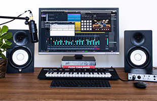 computer-based recording setup with studio monitors, microphone, keyboard controller, display and Steinberg UR24C