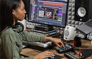 Musician recording onto computer using Steinberg UR24C