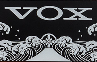 detail view of Vox V847-C wah pedal showing front plate with Vox logo and traditional Japanese artwork