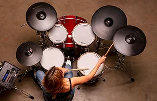 top view of drummer playing Roland BAD706