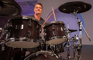 close-up front view of drummer playing Roland VAD706