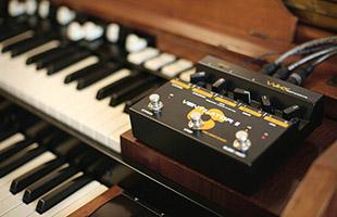Neo Instruments Ventilator II perched on dual manual organ
