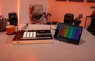 Roland Verselab MV-1 sitting on desk alongside tablet computer running Roland Zenbeats companion app software