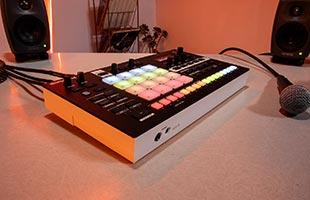 Roland Verselab MV-1 sitting on desk alongside microphone and studio monitor speaker