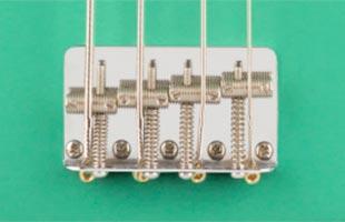 detail image of Fender Vintera '50s Precision Bass showing vintage-style 4-saddle bridge