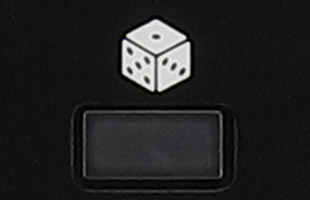detail image of Korg Wavestate top panel showing randomize button labeled with dice icon