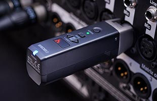 close-up view of Boss WL-30XLR installed in XLR microphone input on audio mixer