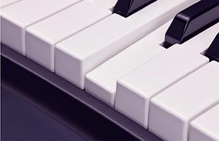 detail image of Yamaha YC61 waterfall keyboard with one key depressed